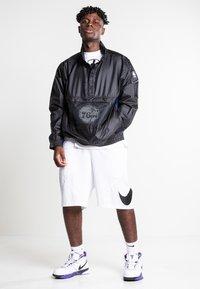 Nike Sportswear - Training jacket - black/black/rush blue/game royal - 1