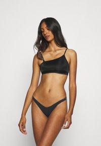 Calvin Klein Underwear - PURE THONG - Thong - black - 1