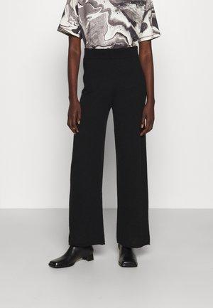 AMIRLA - Trousers - black