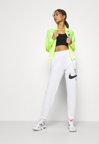 Nike Sportswear - PANT - Tracksuit bottoms - white/black - 1