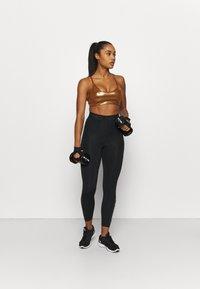 Nike Performance - INDY SHIMMER BRA - Sports bra - gold/tawny/metallic gold - 1