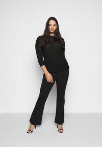 Vero Moda Curve - VMKAMMA FLARED PANT - Bukse - black - 1