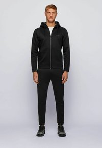 BOSS - Pantalon de survêtement - black - 1
