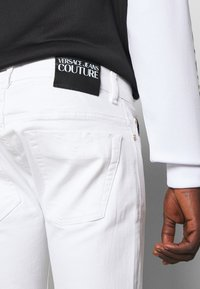 Versace Jeans Couture - DRILL - Straight leg jeans - white - 3