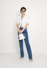 Selected Femme Tall - SLFBLAIR STRAIGHT LONG - Relaxed fit jeans - dark blue denim - 1