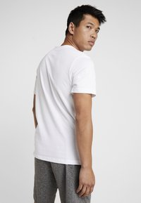 Nike Performance - DRY TEE CREW SOLID - Basic T-shirt - white/black - 2