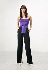 Uterqüe - FLOWING  - Trousers - black - 1