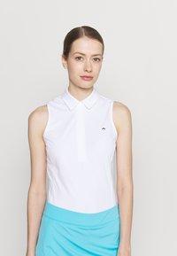J.LINDEBERG - DENA SLEEVELESS GOLF  - Polo shirt - white - 0
