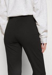 Monki - WILDA TROUSERS - Spodnie materiałowe - black - 3