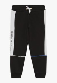 Puma - SEGA PANTS - Pantalon de survêtement - black - 0
