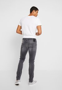 Replay - ANBASS HYPERFLEX - Slim fit jeans - light grey - 2