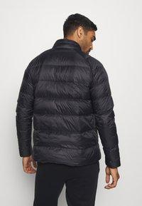 Puma - WARM PACKLITE - Gewatteerde jas - black - 2