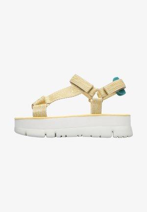 ORUGA UP - Korkeakorkoiset sandaalit - gelb