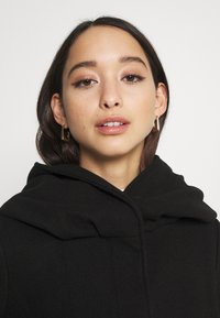 Vila - VICANA HOOD  - Short coat - black