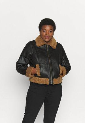 BORG LINED BIKER - Faux leather jacket - black/tan