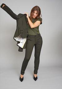 ECHTE - EBONY  - Trousers - sulphur yellow stripe - 1