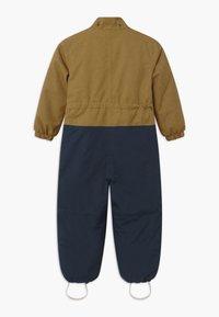 Finkid - TURVA ICE UNISEX - Snowsuit - cinnamon/navy - 2