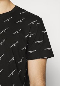 Calvin Klein Jeans - LOGO UNISEX - Print T-shirt - black - 4