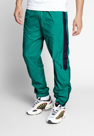 SHIELD - Tracksuit bottoms - neptune green