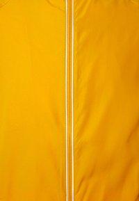Endurance - LESSEND JACKET - Sports jacket - dark yellow - 2