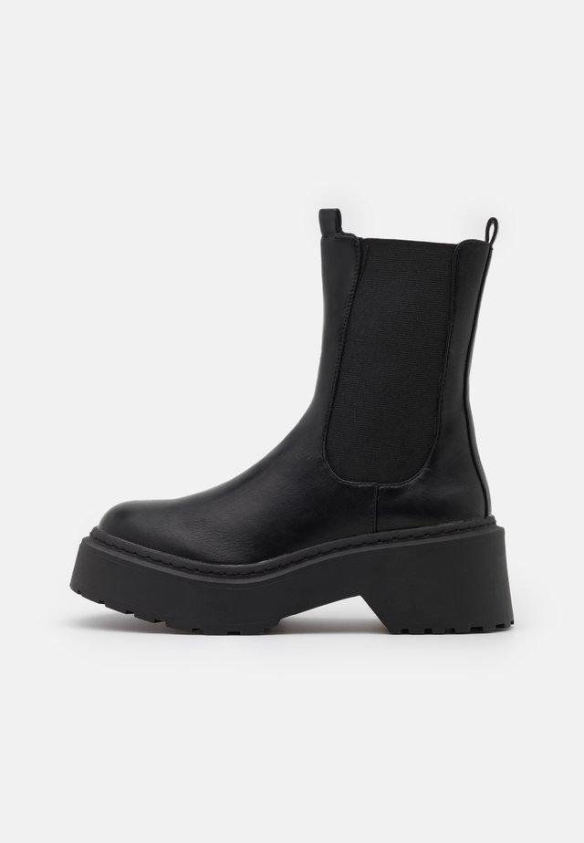 EDIE - Platform ankle boots - black