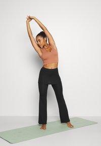 Curare Yogawear - PANTS SKIRT - Teplákové kalhoty - black - 1