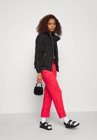 Calvin Klein - LOGO PUFFER JACKET - Winter jacket - black - 1