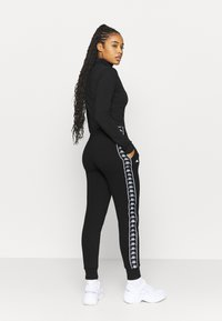 Kappa - HARRIET - Tracksuit bottoms - caviar - 2