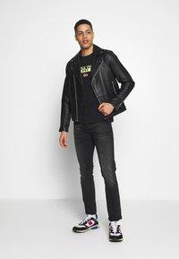 Napapijri - SARAS SOLID - T-shirt med print - black - 1