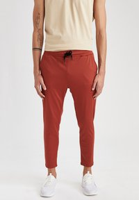 DeFacto Fit - SLIM FIT  - Pantaloni sportivi - orange - 0