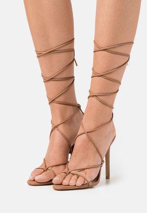 GLAOSA - T-bar sandals - cognac