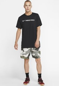 Nike Performance - DRY TEE PRO - Camiseta estampada - black - 1