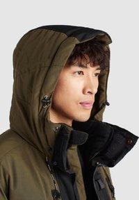 khujo - NANDU - Winter jacket - oliv-schwarz kombo - 7