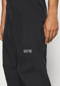 Gore Wear - GORE® C3 GORE-TEX PACLITE® - Trousers - black - 3