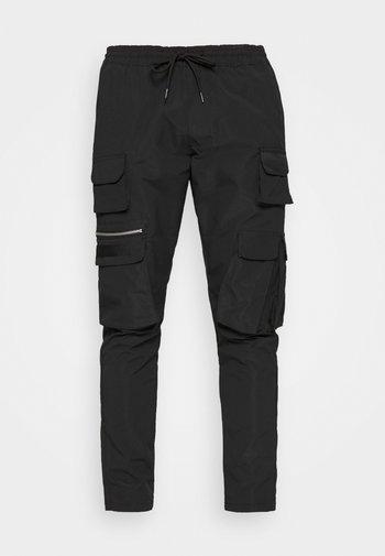 MTR-SWIFT - Cargo trousers - black