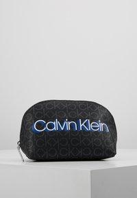 Calvin Klein - MONOGRAM MAKE UP BAG - Trousse de toilette - black - 0