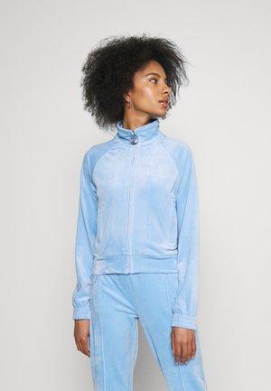 TANYA TRACK - Zip-up sweatshirt - powder blue