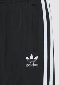 adidas Originals - ADICOLOR PRIMEGREEN PANTS - Pantalones deportivos - black/white