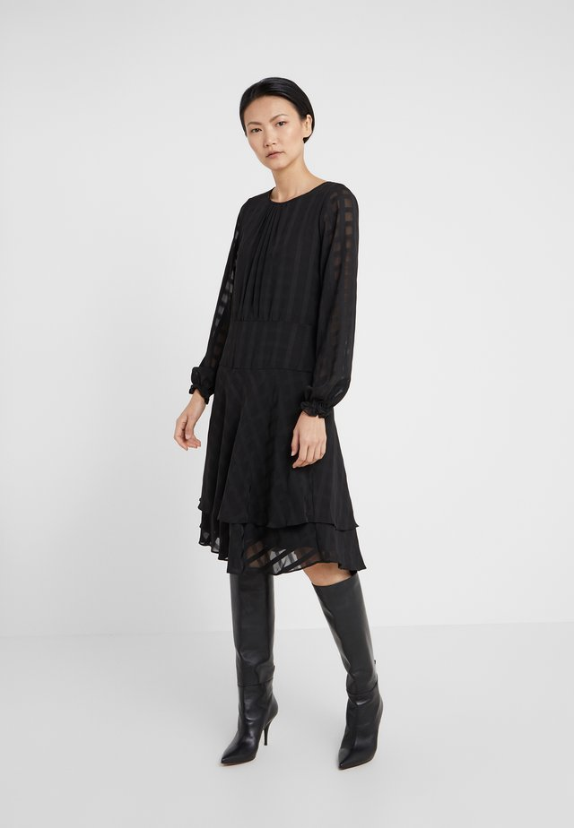 FIT FLARE WITH DOUBLE LAYER SKIRT - Day dress - black