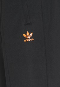 adidas Originals - TRACK PANT UNISEX - Tracksuit bottoms - black/trace orange - 6