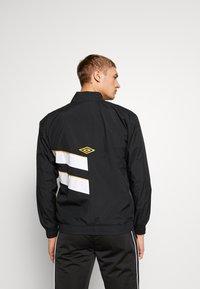 Umbro - DIAMOND CUT TRACK JACKET - Training jacket - black/brilliant white - 2
