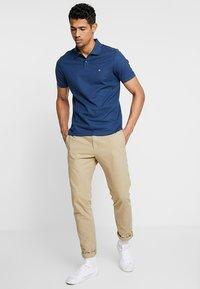 Calvin Klein - REFINED LOGO SLIM FIT - Polo shirt - blue - 1