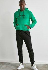 Trendyol - Pantalon de survêtement - black - 1