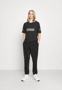 adidas Originals - R.Y.V. SWEATPNT ORIGINALS PANTS - Tracksuit bottoms - black - 1