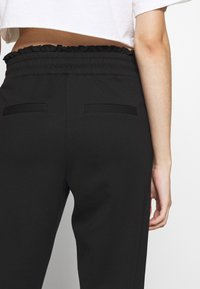 ONLY Petite - ONLPOPTRASH EASY FRILL PANT - Trousers - black - 3