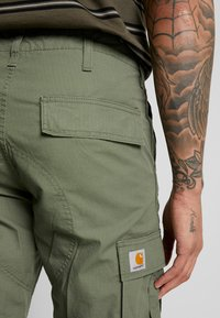 Carhartt WIP - REGULAR COLUMBIA - Cargo trousers - dollar green rinsed - 5