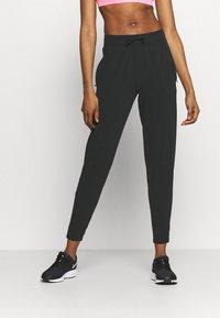 Nike Performance - WARM PANT RUNWAY - Tracksuit bottoms - black/reflective silver - 0