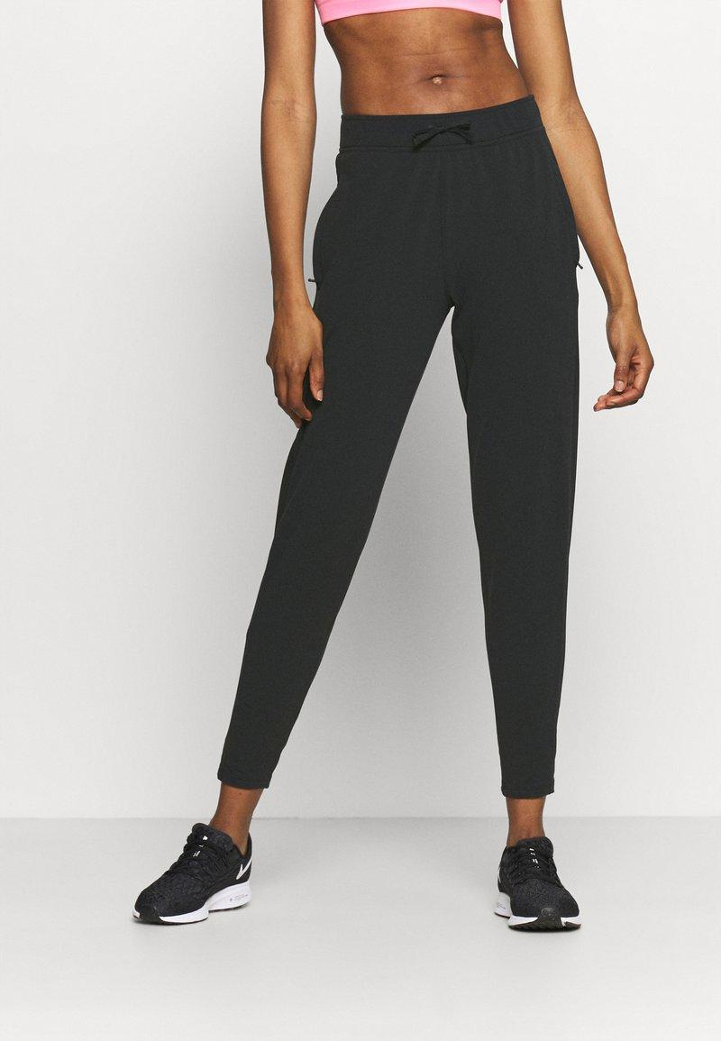 Nike Performance - WARM PANT RUNWAY - Tracksuit bottoms - black/reflective silver