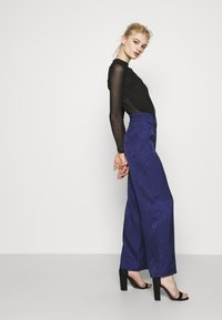 Never Fully Dressed - VOGUE - Trousers - blue - 3