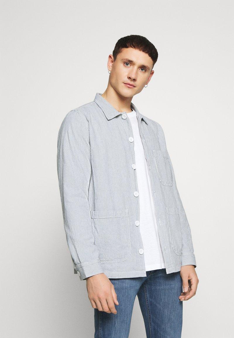 Dedicated - SALA THIN STRIPES - Shirt - blue
